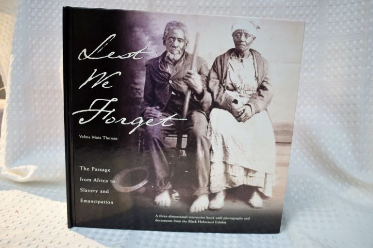 Lest We Forget The Passage from Africa to Slavery and Emancipation: A Three-Dimensional Interactive Book with Photographs and Documents from the Black Holocaust Exhibit. Velma Maia Thomas.